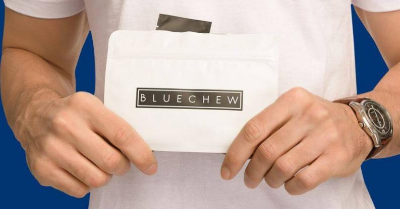 man holding a bluechew